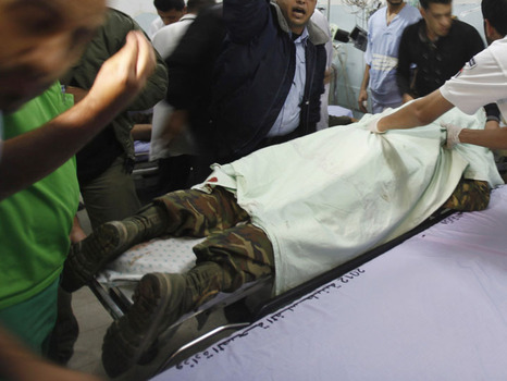 A dead Hamas terrorist on the table in Gaza early this morning.