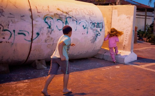 Children in southern Israel running to a bomb shelter. Who cares? (Picture: www.tabletmag.com).