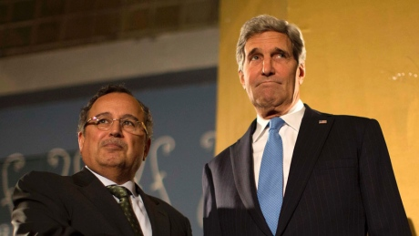 A dour John Kerry at a Cairo Airport Hotel with Egyptian Foreign Minister Nabil Fahmy yesterday (picture source: cbc).