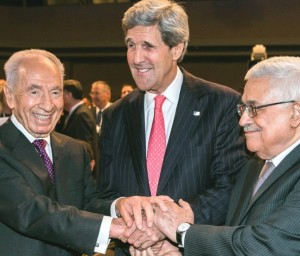 Peres hasn't stopped shaking Abbas's hand since they were on the White House Lawn for the Oslo Accords ceremony decades ago. Now, instead of Clinton, we have Kerry (picture: Times of Israel).