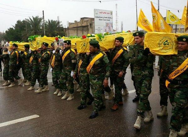 More dead Hezbollah terrorists being carried in a funeral march in Lebanon.