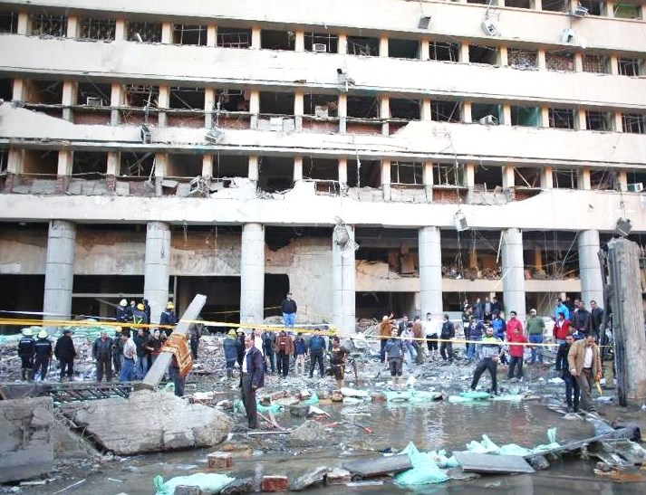 The scene outside the police headquarters today.  If you look closely, you make out a circular crater filled with water in the front of the picture where the bomb detonated (picture: Yahoo).