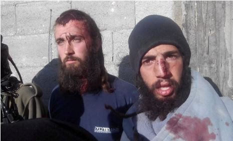 Two of the 10 Jews who were beaten by Palestinians yesterday (picture: Haaretz).