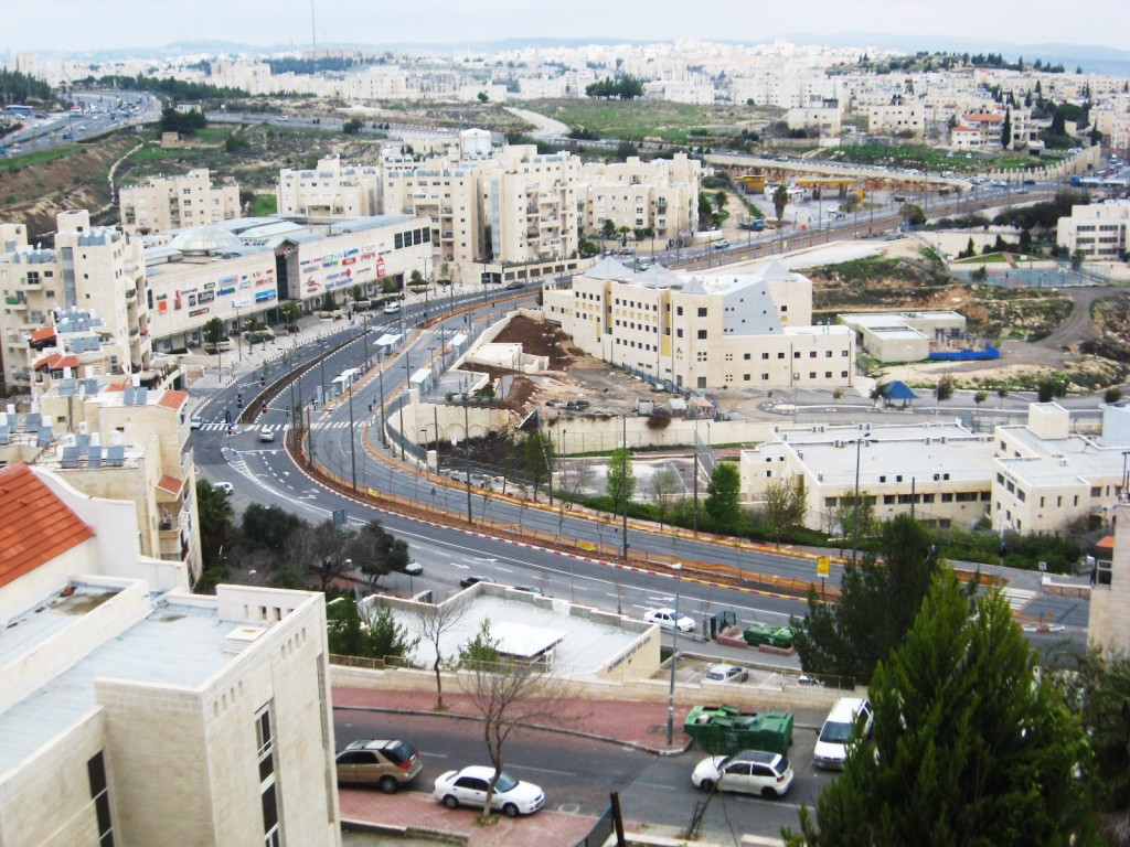 A picture of the center of the Pisgat Ze'ev neighborhood of northern Jerusalem. Down the center of the road runs the Jerusalem Light Rail track which your humble servant has ridden many times.
