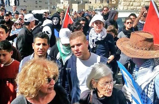 "The scene at the head of the ""peaceful march"" in Hebron today. Note the self-proclaimed ""international human rights activists"" leading the way (photo: Haaretz)."
