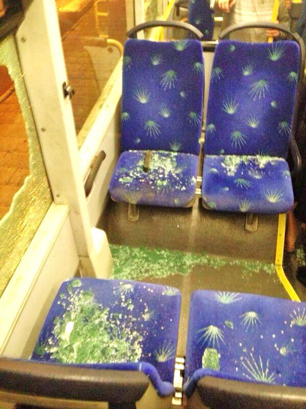 """The inside of a bus that was struck by """"rocks"""" at the Dung Gate last night (picture: observation)."""