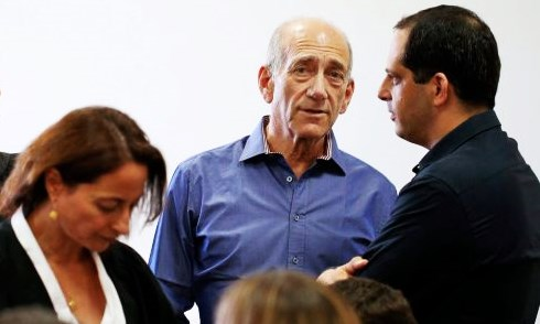 Prison bound: an unhappy Olmert with his downcast lawyer in Tel Aviv this morning (photo: Haaretz).