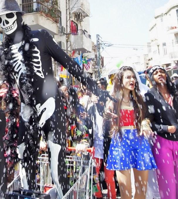 Dancing amidst falling confetti down a street in Tel Aviv (photo: Haaretz).