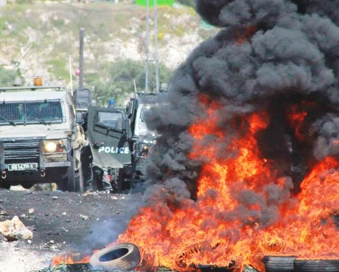 "This picture from Samaria that appeared on a Palestinian site on Friday shows Israeli forces stymied by ""rocks"" and burning tires--and hamstrung by political correctness."
