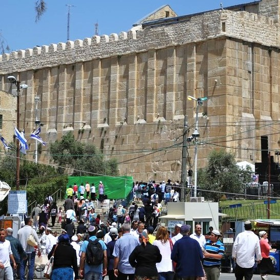 Some of the huge crowd streaming toward the Cave of the Patriarchs in Hebron yesterday.