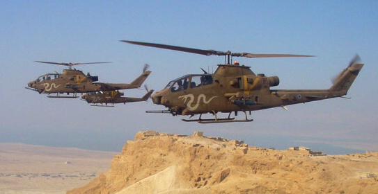 Israeli Cobra helicopters flying over Masada. They are now to be permanently grounded (photo: wikipedia).