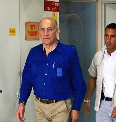 A crestfallen Olmert leaves the courtroom. He didn't get away with his crimes this time (picture Ynet).