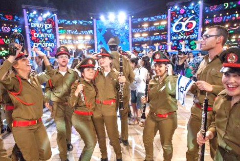 Here some IDF band members start whooping it up! (Picture: Haaretz).