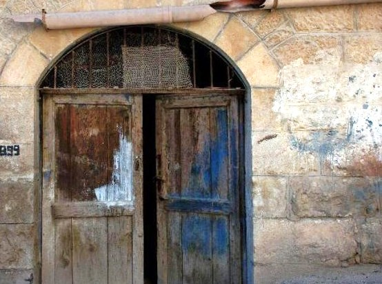 An abandoned Christian home in Bethlehem (note that the anti-Christian graffiti has been painted over). Places like this were not on the Pope's agenda.  Picture: Fox news.