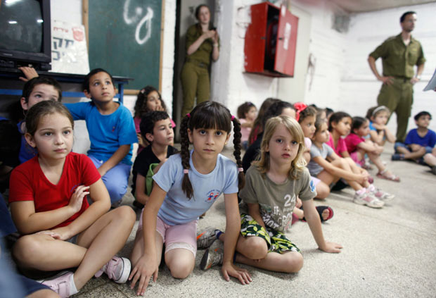 Children in southern Israel are spending much of their school day like this.