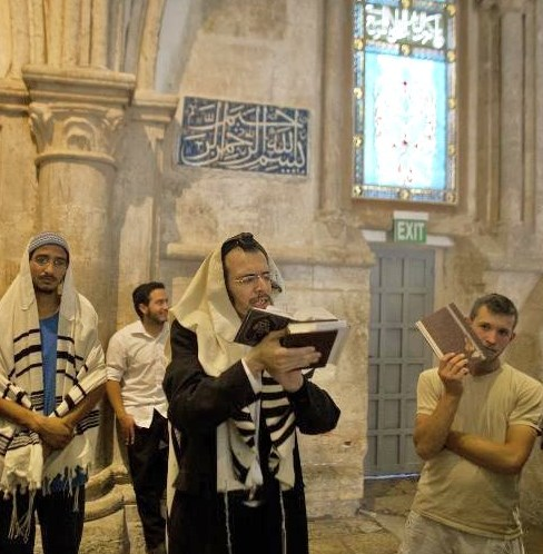 Orthodox Jews exercising their right to pray in the room above David's Tomb (photo: AFP).