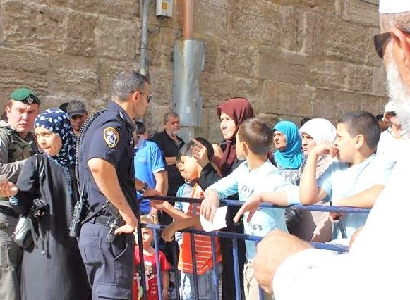 A Border Guard (green uniform) and Jerusalem policeman (blue) blocking Muslim entry to the Har Habayit (Temple Mount).