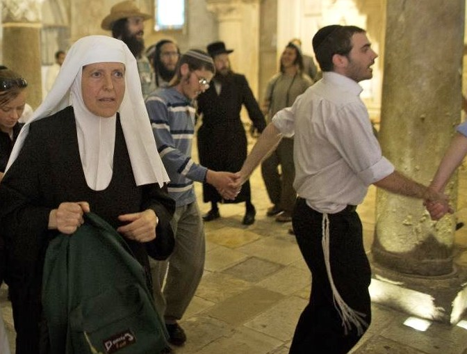 "This picture appears to show a ""victimized"" Catholic nun fleeing from ""radical"" Jews in the room. In reality, she is merely leaving after praying in a separate part of the same room (photo: Agence France Presse)."