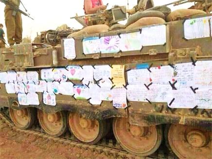 Letters from Israeli kids adorn an IDF tank.