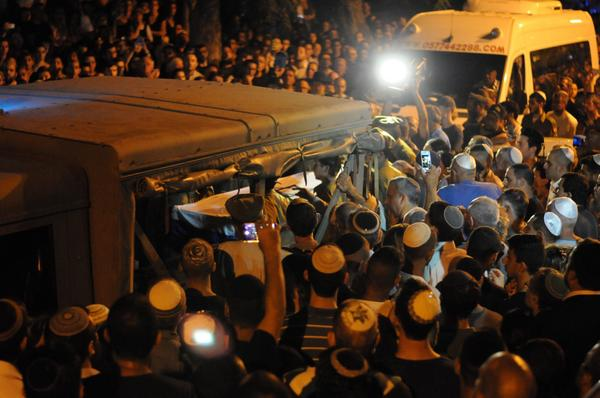 The body of Sgt. Carmeli being removed from the military vehicle at the cemetery last night.