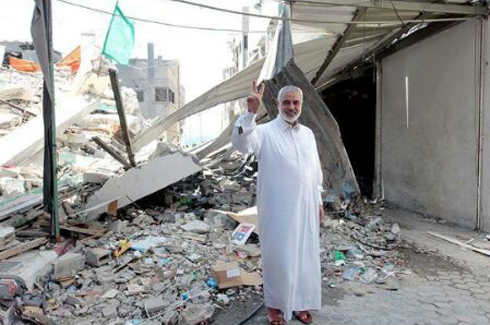 Haniyeh flashing the victory sign in the rubble. The Qataris will quickly build him a palatial estate in Gaza.