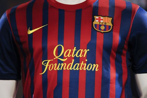 The Al-Thani family, the Qatar Foundation, Nike, the FC Barcelona playing jersey with the Barcelona logo.