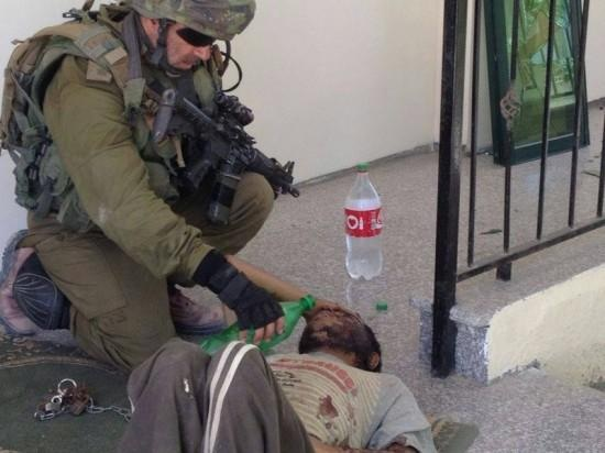 This picture of an Israeli soldier attempting to comfort a Palestinian yesterday is especially revealing.