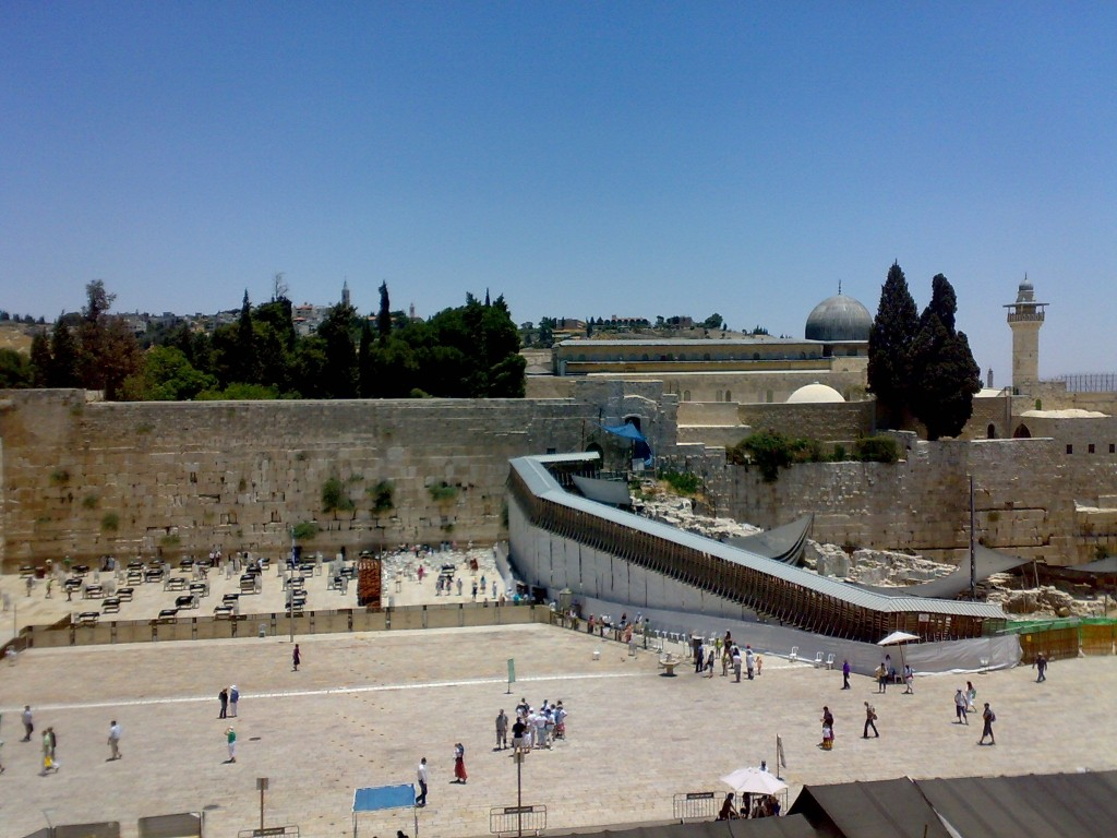Note the wooden ramp up to the Mughrabi Gate which roughly bisects the Women's Prayer Area at the Kotel.