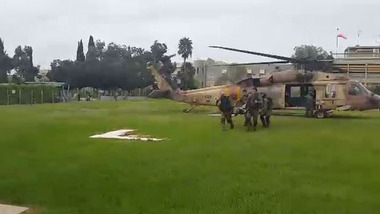 Wounded Caracal soldiers being taken from a helicopter at Soroka Hospital this afternoon.