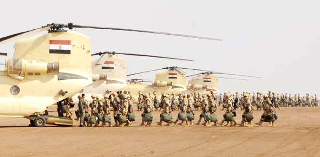 Egyptian soldiers boarding helicopters on their way to the Gaza border yesterday.