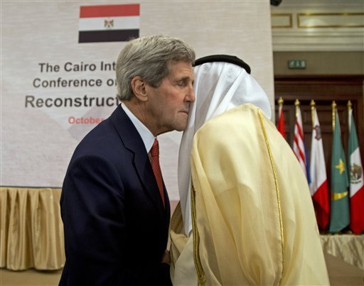 John Kerry in a loving embrace in Cairo this week.