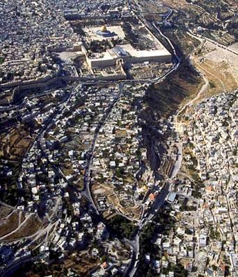 The City of David is located on the top of the hill in the foreground just to the south of the Temple Mount and west of the small valley.