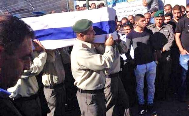 The body of Jidan Assad is taken for burial in the military cemetery in Beit Jann.