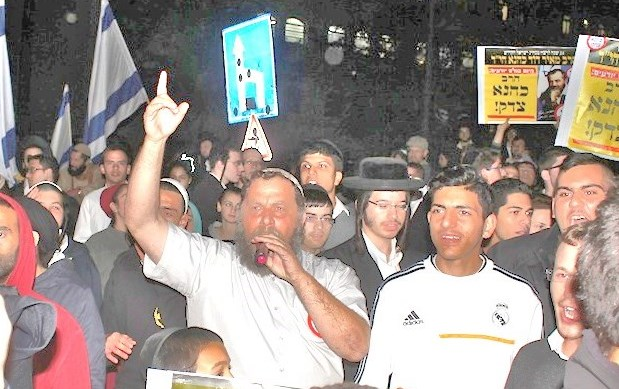 """The signs read: """"Rabbi Kahane was right."""""""