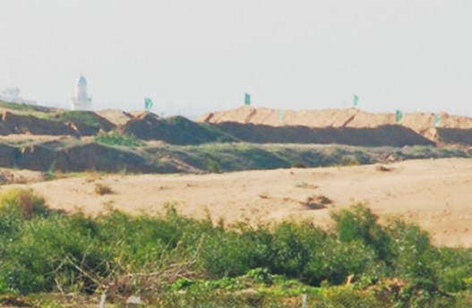 These berms are being made with bulldozers supplied to Hamas by Israel for moving rubble created duing the summer war (photo Barel Ephraim).