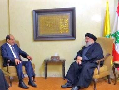 Al-Maliki (left) with Nasrallah.