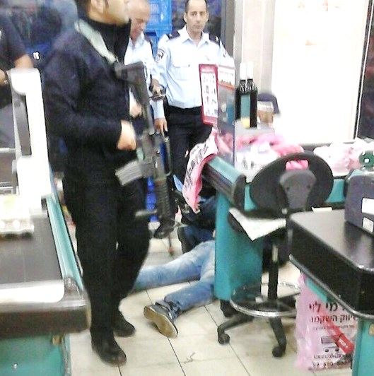 The scene in Rami Levy a few hours ago. The wounded terrorist is on the floor.