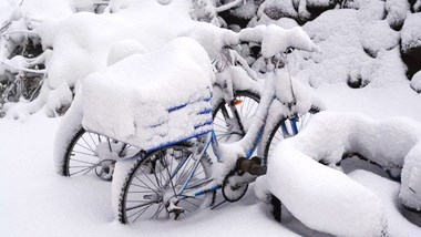 Snow covers two bicycls on the Golan this morning (photo: walla).