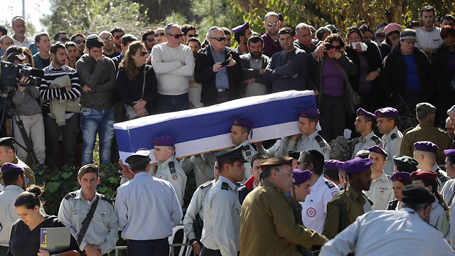Soldiers carry the coffin of