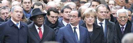 Left to right: French President Francois Hollande is surrounded by Heads of state including (LtoR) Israel's Prime Minister Benjamin Netanyahu, Mali's President Ibrahim Boubacar Keita, Germany's Chancellor Angela Merkel, European Council President Donald Tusk, Palestinian President Mahmoud Abbas, Italy's Prime Minister Matteo Renzi and Switzerland's President Simonetta Sommaruga as they attend the solidarity march (Marche Republicaine) in the streets of Paris January 11, 2015. CREDIT: REUTERS/PHILIPPE WOJAZER