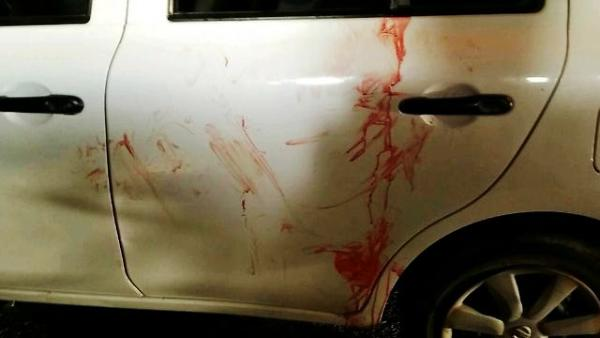 The side of the blood-drenched car (photo: Tazpit).
