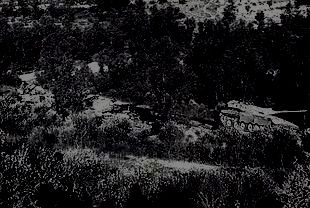 This is probably the last picture made of Commander Tzur's tank--you can barely make out a Syrian tank that had just been destroyed behind it.