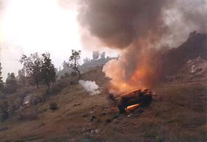 A Syrian tank that was still burning at dawn after the battle.