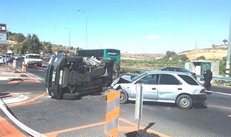 "The bulldozer attack at Neve Daniel yesterday. Note the Israeli military vehicle on its side. Three soldiers were ""moderately"" wounded. The terrorist was critically wounded."