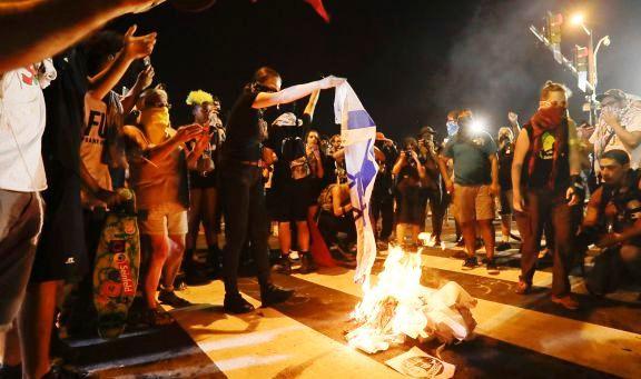 "While chanting ""intifada, intifada, intifada"", Bernie Sanders supporters burn the Israeli flag outside of the Democratic National Convention in Philadelphia last night."