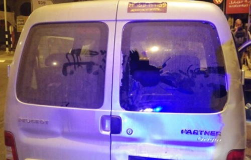 """Anyone driving in Judea and Samaria these days is running the terrorist gauntlet of """"rock"""" and Molotov firebombs. The people in this van were lucky because they were hit in the rear (note the dents as well as the shattered back glass)."""
