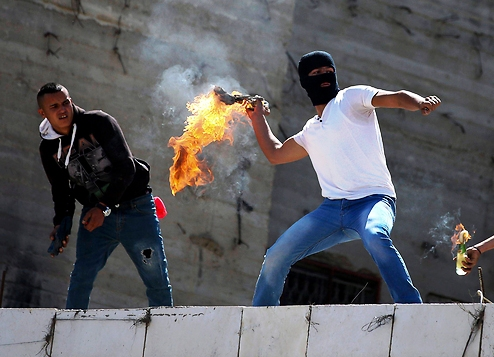 Is this Molotov-thrower a terrorist? Only if he is lucky enough to wound an Israeli--or burn someone alive.
