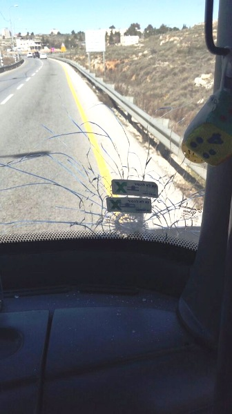 The windshield of this bus was shattered near Tekoa. The bus driver maintained control of the bus, but several passengers were treated for trauma.