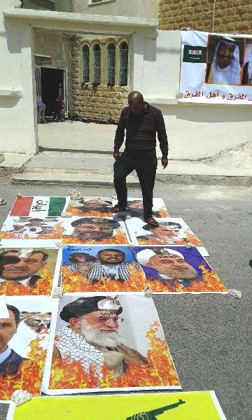 A Jordanian stomping on the pictures of Iranian and Hezbollah leaders--the ultimate Arab insult.