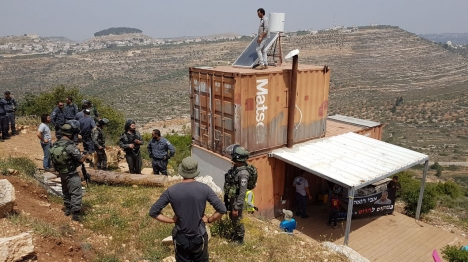 The man on the roof of his container at Givat refused to leave until he was surrounded and forcibly removed by the police (hakolyehudi).
